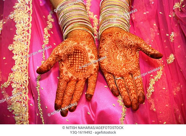 Traditional henna decorations on hand of an Indian bride