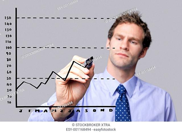 Businessman drawing on glass screen