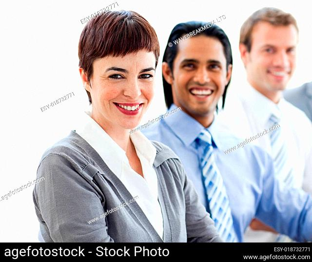 Multi-ethnic co-workers smiling at the camera