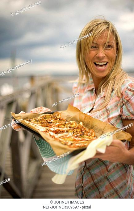 A woman carrying a plate with seafood