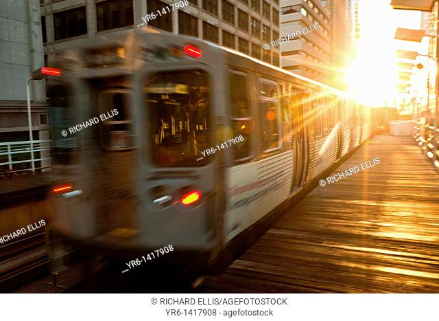 A train in the Chicago rapid transit system known as the'L' arrives in a station in the LOOP in Chicago, IL, USA