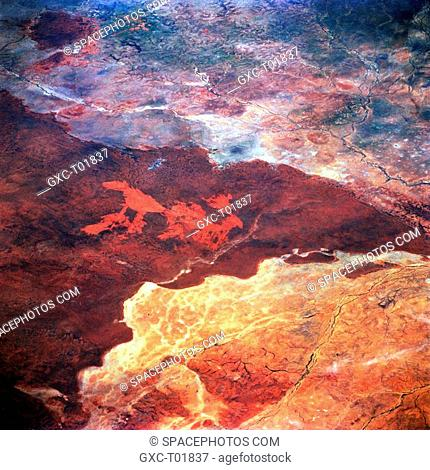 The northeast end of the slightly elevated Barkly Tableland darker area shows a marked color contrast in this semiarid landscape roughly 60 miles 97 kilometers...