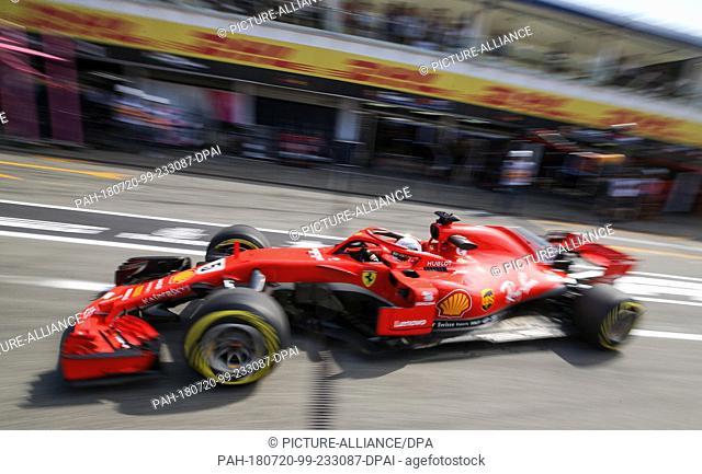 20 July 2018, Germany, Hockenheim: Motorsport: Formula 1 World Championship, German Grand Prix: Germany's Sebastian Vettel of the team Scuderia Ferrari driving...