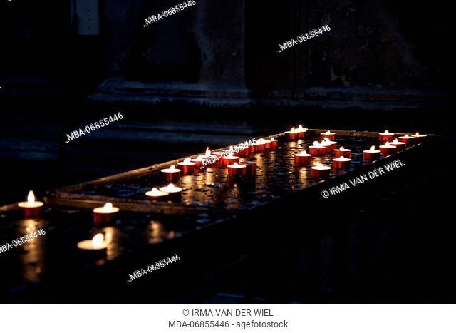 Burning candles in the Basilica di Santa Maria della Salute, Venice
