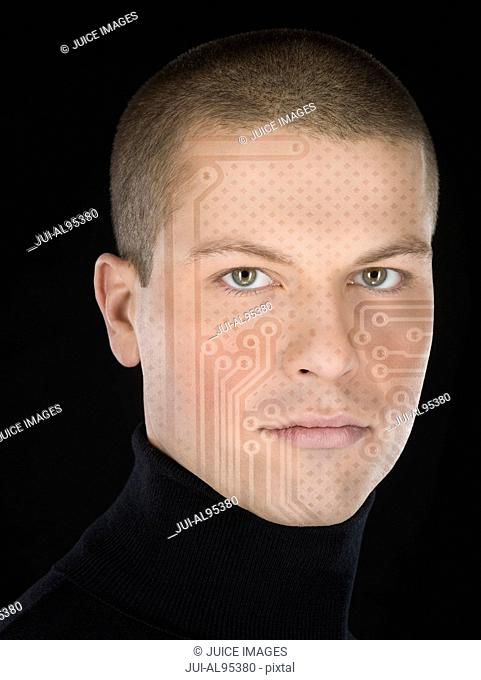 Man with circuit board pattern on face