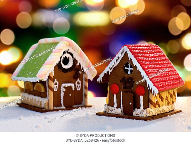 gingerbread houses over christmas lights