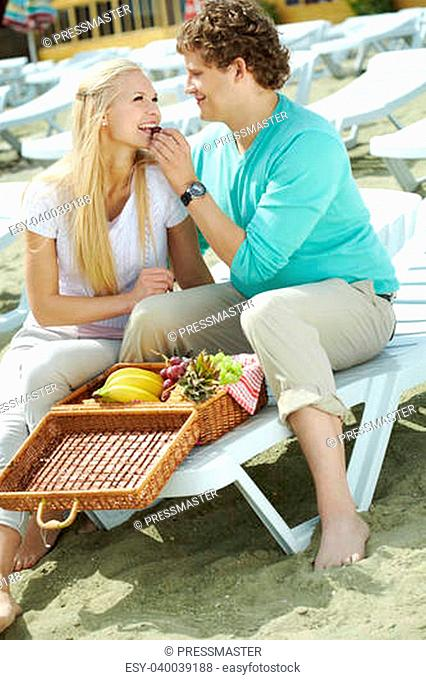 Photo of happy couple having lunch together on resort