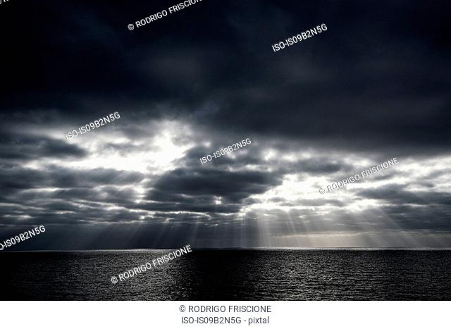 Sunbeams through clouds over sea, Guadalupe Island, Mexico