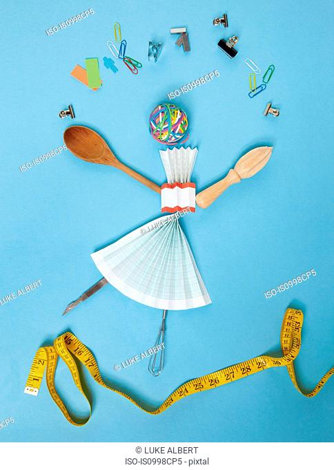 Household objects and stationery arranged against blue background