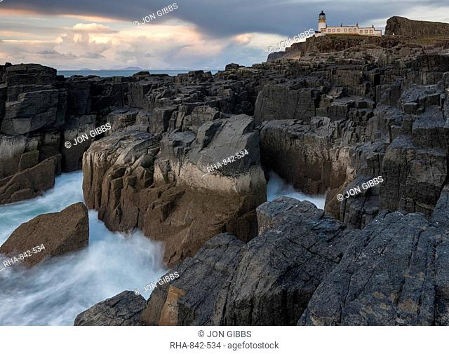 The dramatic coastline and lighthouse at Neist Point, Isle of Skye, Inner Hebrides, Scotland, United Kingdom, Europe