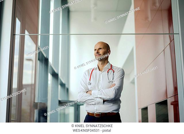 Doctor standing in hospital with stethoscope around his neck