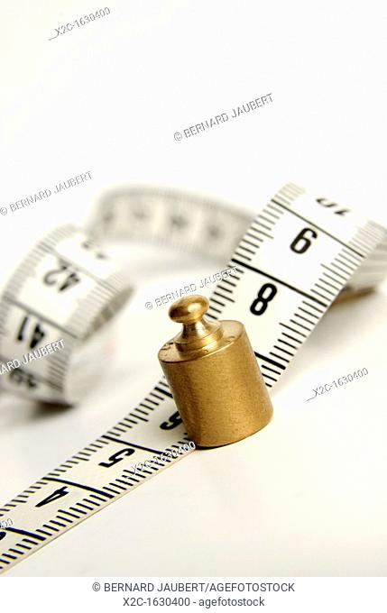 Tape measure, scale weight, symbolic image weight cuts