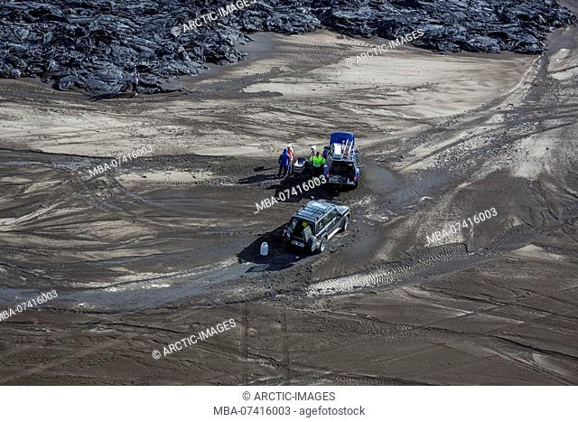 Aerial view of scientists and their jeeps by the lava flows. August 29, 2014 a fissure eruption started in Holuhraun at the northern end of a magma intrusion