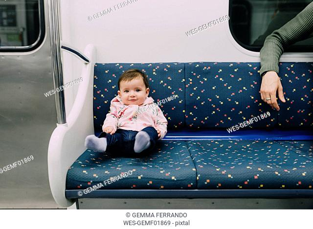 Cute baby girl traveling by subway
