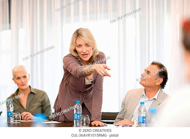 Businesswoman pointing at colleague