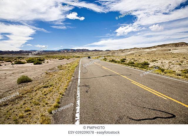 Road through Desert landscape in front of Henry Mountains near Hanksville, Utah, USA