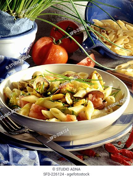 Penne with seafood, courgettes and tomatoes