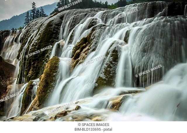 Waterfall in rural landscape