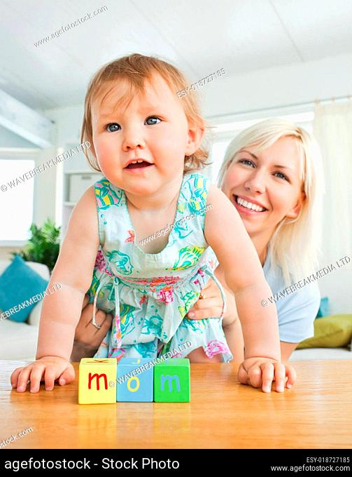 Radiant mother playing with her daughter