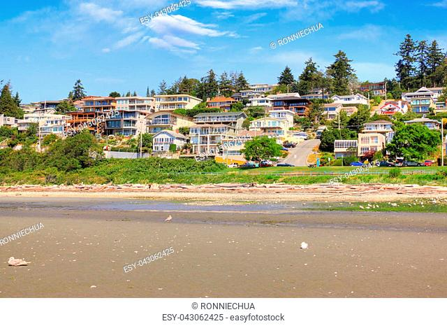 Low tide on the sandy beach at the popular quaint seaside community of White Rock surrounding Semiahmoo Bay near Vancouver in British Columbia, Canada