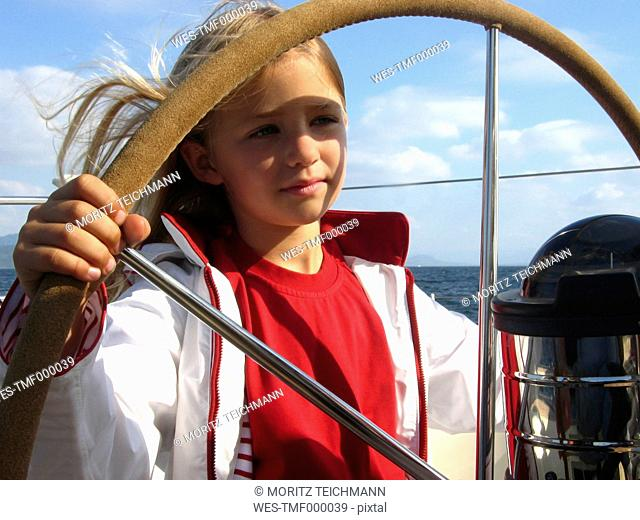 Norway, Stavanger, portrait of girl at helm