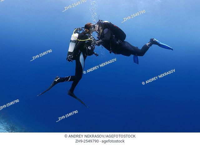 Young couple divers kissing underwater, Indian Ocean, Maldives