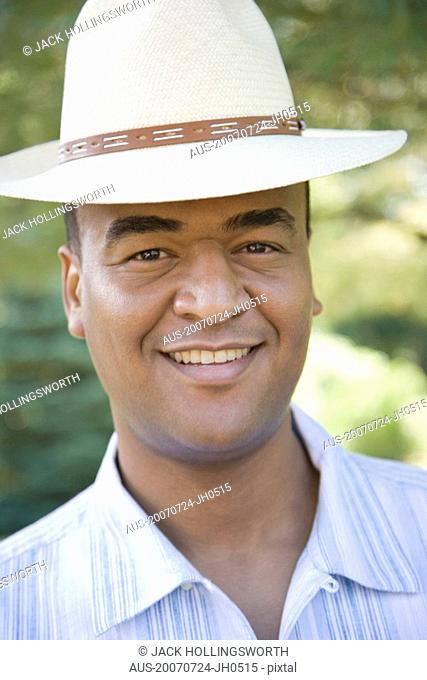 Portrait of a mid adult man wearing a hat and smiling