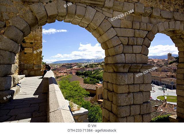 Looking through the Roman aqueduct the townscape, Segovia, Castile-Leon, Spain, Europe
