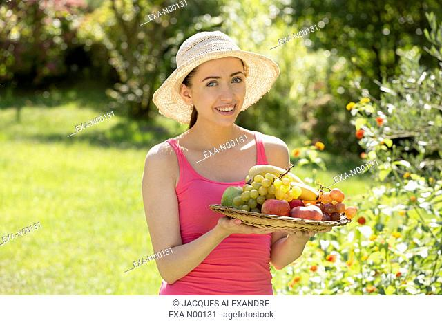 Woman offering fruits