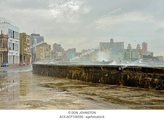 Street photography in central Havana- Surf crashing on the sea wall along the Malacon