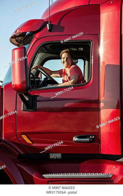 Portrait of a Caucasian woman driver and her commercial truck