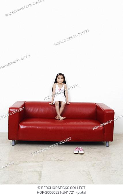 Portrait of a girl sitting on a couch