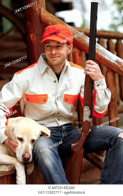Dog And Hunter Relax On Porch After Hunt