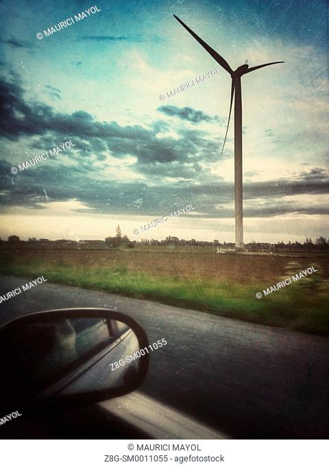 Windmill from a car, near Gent, Belgium
