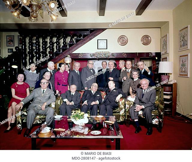 Italian publisher Arnoldo Mondadori posing in a group photo inside his villa. Along with him, Italian writers Salvator Gotta and Piero Chiara