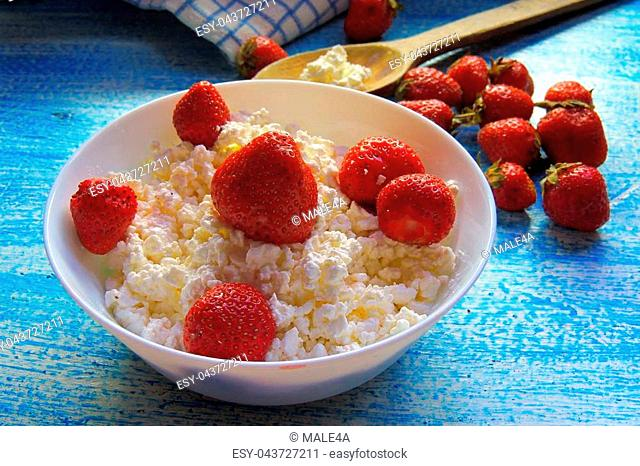 Dessert of cottage cheese with fresh strawberries