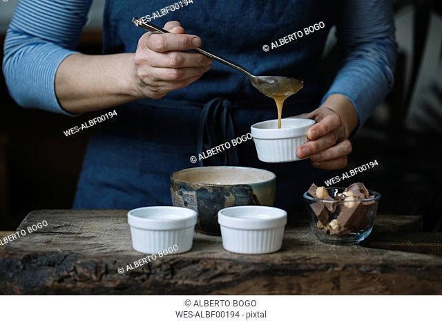 Woman preparing dessert, partial view