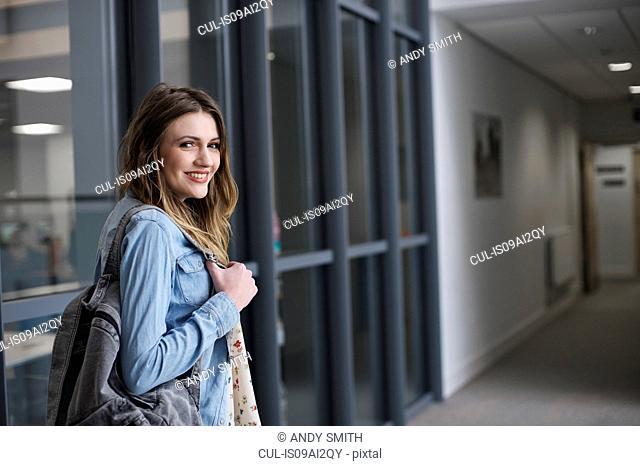 Young woman wearing denim shirt, portrait
