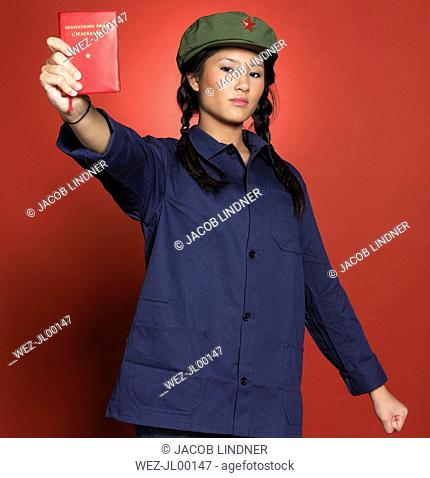Young chinese woman, holding red bock