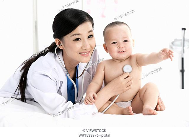 The doctor is for baby check body