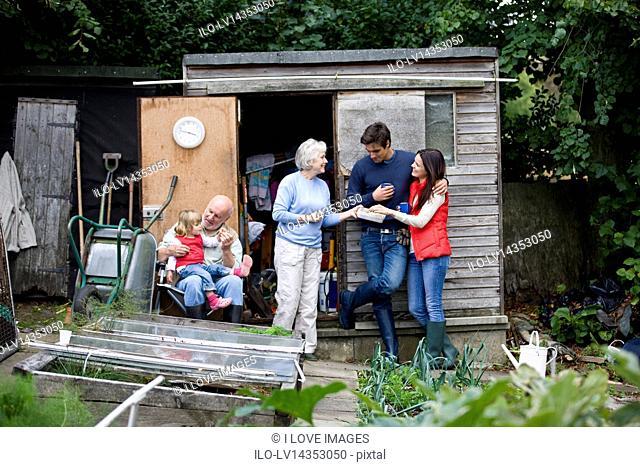 Family having a break on an allotment