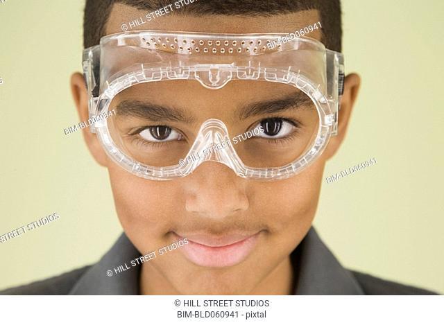 Mixed Race boy wearing protective eyewear