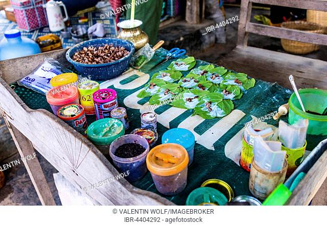 Market stall showing preparation of traditional chewing tobacco and betel nut, Nampan, Inle Lake, Shan State, Myanmar