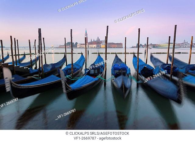 Venice, Italy. The gondolas swaying rocked by the sea in the Grand Canal, in front of St. Giorgio Maggiore
