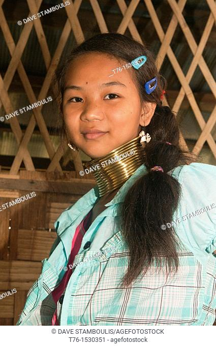 Mo Ji, one of the last young Padaung Longneck Karen girls to wear the brass coils in her village of Ban Nai Soi in northern Thailand