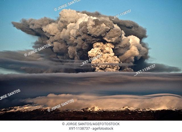 The ash plume of Eyjafjallajökull at sunset shortly after the start of the eruption