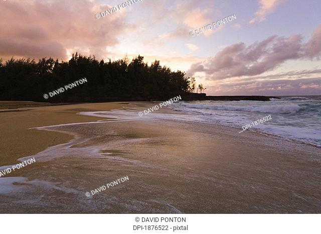 Kauai, Hawaii, United States Of America, Wave Washing Over Lumihai Beach At Sunset
