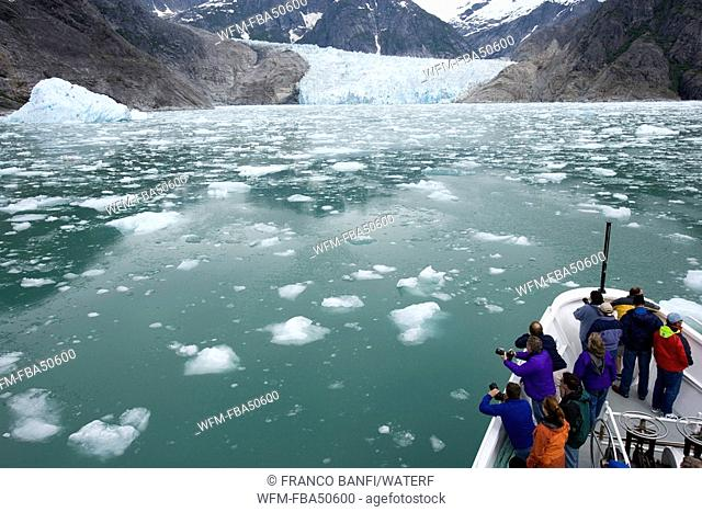 people enjoy the view of the glacier from liveaboard, LeConte Glacier Bay, USA, Alaska