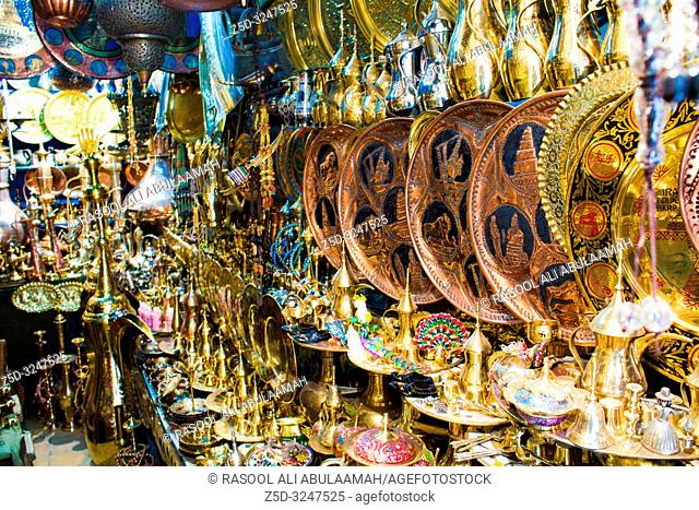 Baghdad, Iraq – March 19, 2014: It is Iraqi market In the city of Baghdad ,Handles the sale of business and industry and paintings on metal and metal pots