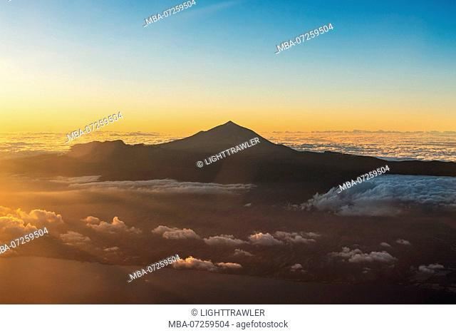 Aerial view of the Canary Island of Tenerife with the summit of Mount Teide at sunset